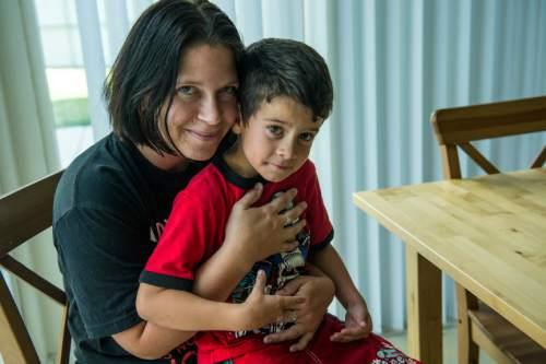Chris Detrick  |  The Salt Lake Tribune Crystal Everett and her son Collin Topchi, 5, pose for a portrait at LifeStart Village Friday August 26, 2016.