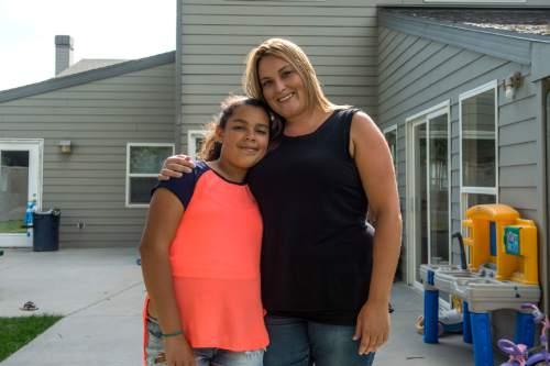Chris Detrick  |  The Salt Lake Tribune Heidi Lund and her daughter Carris Dennis, 10, pose for a portrait at LifeStart Village Friday August 26, 2016.