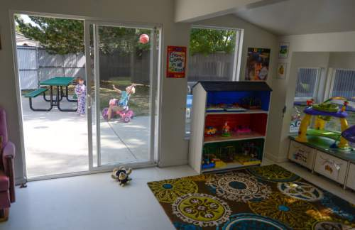 Francisco Kjolseth | The Salt Lake Tribune Kids run around near the playroom at the LifeStart Village in Midvale, a multi-faceted program for single homeless parents, which includes day-care facilities and lodgings.