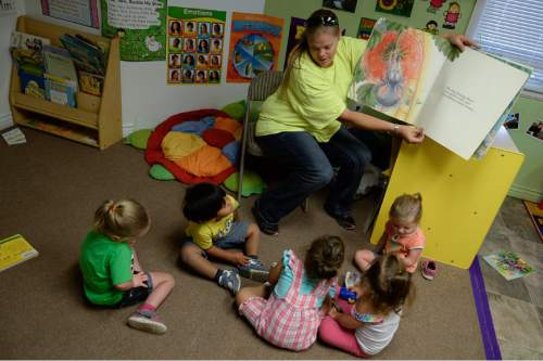 Francisco Kjolseth | The Salt Lake Tribune Karri Hallman reads The Big Hungry Bear to a group of kids at the Daycare and Child Development Center in Midvale. The Family Support Center operates a multi-faceted program for single homeless mothers, which includes day-care facilities and lodgings to help them get back on their feet.