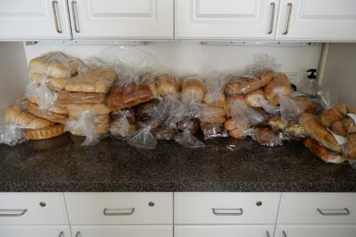 Francisco Kjolseth | The Salt Lake Tribune Bread from numerous local businesses is donated to the LifeStart program in Midvale. The housing program which works through three phases, provides 54 units for single parents who were homeless.