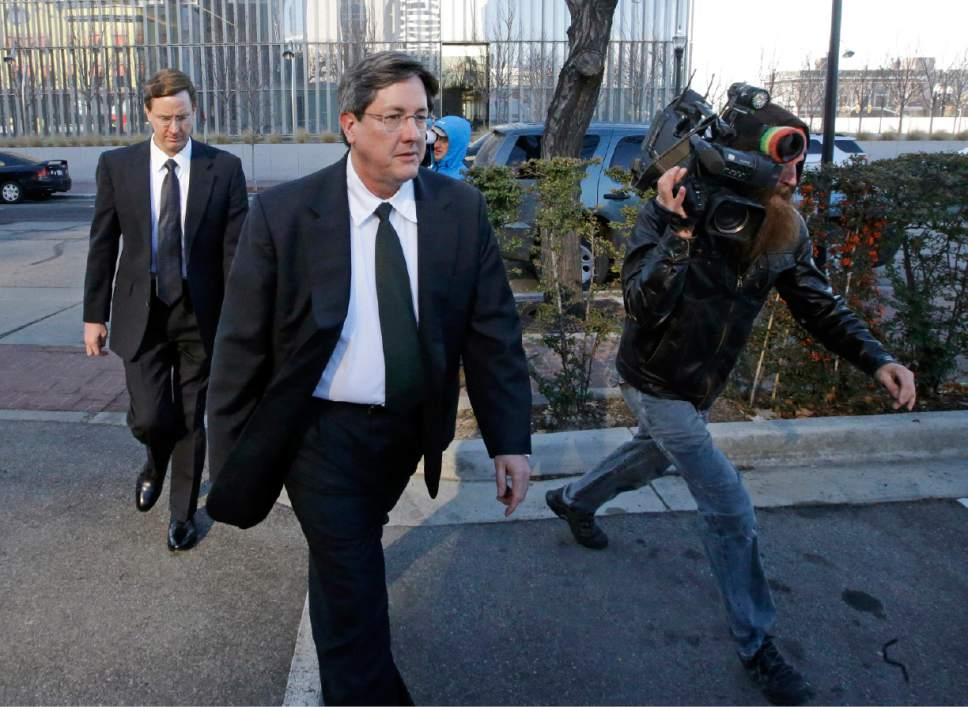 AP Photo/Rick Bowmer | In this Wednesday, Jan. 21, 2015 file photo, brothers of polygamous sect leader Warren Jeffs, Lyle, foreground, and Nephi, leave the federal courthouse in Salt Lake City. The U.S. Attorney's Office for Utah says  Warren Jeffs, now imprisoned in Texas, has named Nephi Jeffs the new bishop of Hildale, Utah, and Colorado City, Ariz., the traditional home base of the Fundamentalist Church of Latter-Day Saints.