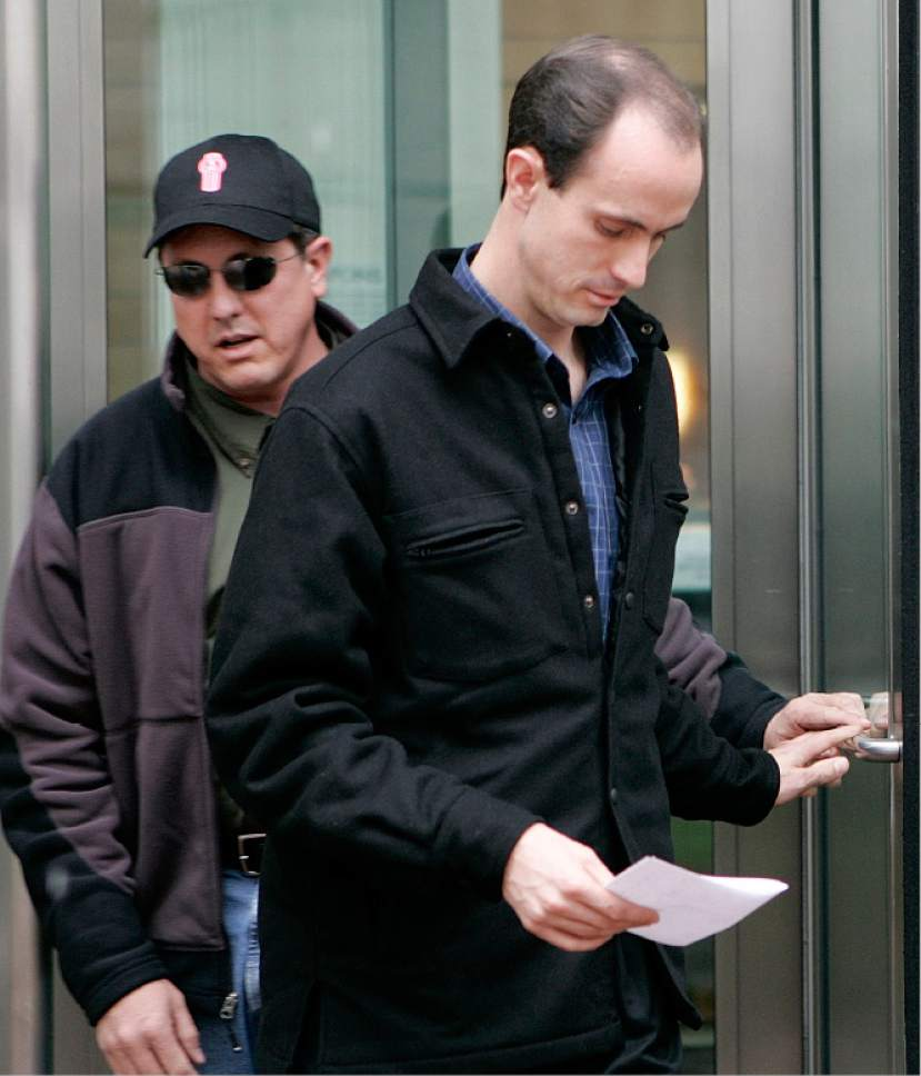 Seth Steed Jeffs, 32, right, of Hildale, Utah, leaves the federal courthouse in Denver with his brother Lyle, Thursday, Nov. 17, 2005, after entering a plea of not guilty on charges of concealing his brother, fugitive polygamist sect leader Warren Steed Jeffs. Seth Jeffs was arrested after a traffic stop Oct. 28 in Pueblo County south of Denver. Authorities said he had nearly $142,000 in cash, about $7,000 worth of prepaid debit and phone cards and Warren Jeffs' personal papers in his SUV. (AP Photo/Ed Andrieski)