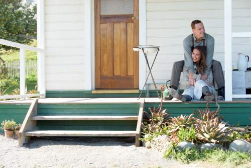 """This image released by DreamWorks II Distribution Co., LLC., shows Michael Fassbender as Tom Sherbourne and Alicia Vikander as his wife Isabel in a scene from """"The Light Between Oceans,"""" based on the acclaimed novel by M.L. Stedman. (Davi Russo/DreamWorks II Distribution Co., LLC. via AP)"""