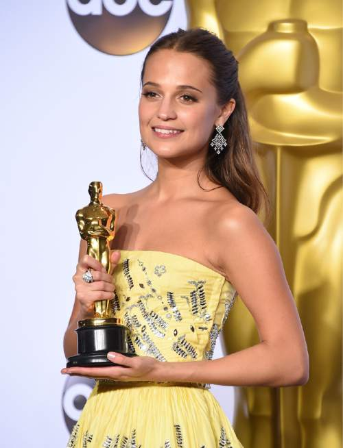 """Alicia Vikander poses with the award for best actress in a supporting role for """"The Danish Girl"""" in the press room at the Oscars on Sunday, Feb. 28, 2016, at the Dolby Theatre in Los Angeles. (Photo by Jordan Strauss/Invision/AP)"""
