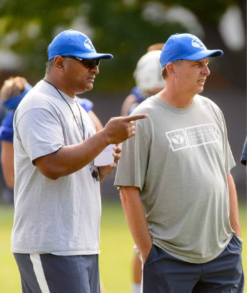 Trent Nelson  |  The Salt Lake Tribune New coach Kalani Sitake oversees his first BYU fall camp practice, Friday August 5, 2016 in Provo. At right is offensive coordinator Ty Detmer.