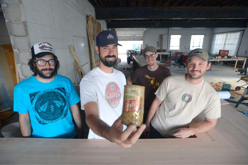 Al Hartmann  |  The Salt Lake Tribune  Beer partners Colby Frazier, Tom Fisher Riemondy, Tim Dwyer, and Steven Brown stand behind the bar counter, still under construction, for the new Fisher Brewing pub that will open in late fall of 2016 at 320 W. 800 S in Salt Lake City. They are starting up the A. Fisher Brewing Co., first opened in 1884 by Albert Fisher. It closed in 1917 for state prohibition and reopened on 1934, with the repeal of national Prohibition. It closed for good in the 1960s. Tom Fisher Riemondy, a great grandson of Albert Fisher holds up a relic of a Fisher Beer can from the old days.