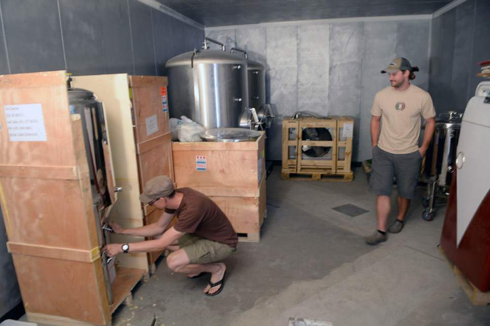 Al Hartmann  |  The Salt Lake Tribune  Tim Dwyer and Steven Brown check out the new stainless steel tanks for brewing in the cold room still under construction for the new Fisher Brewing pub that will open in late Fall of 2016 at 320 W. 800 So. in Salt Lake City.