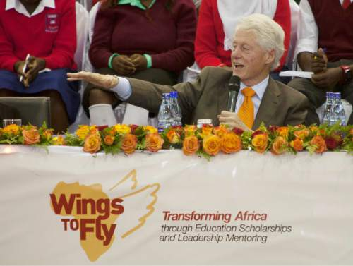 FILE - In this May 2, 2015 file photo, former President Bill Clinton speaks at the Kasarani Sports Complex in Nairobi, Kenya, during a tour of Clinton Foundation projects in Africa. As Bill Clinton's presidency ended, he was popular, yet still tainted by scandal, and struggling to find his footing after eight years in the White House. He eventually channeled his energy into the global philanthropy that bears his name and has shaped so much of his post-presidential legacy.   (AP Photo/Sayyid Azim, File)