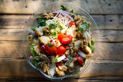 Lennie Mahler     The Salt Lake Tribune  Aubergine & Company's Dream Salad includes romaine, spinach, chicken, red onions, apples, walnuts, parmesan cheese, grape tomatoes, red and green peppers, and basil. Photographed at Aubergine at 2122 S. Highland Drive in Sugar House, Friday, Aug. 19, 2016.