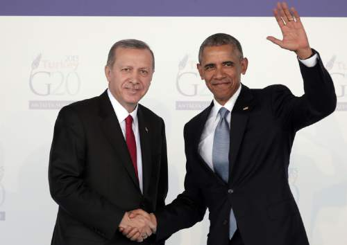 FILE - In this Nov. 15, 2015 file photo, President Barack Obama shakes hands with Turkish President Recep Tayyip Erdogan in Antalya, Turkey.  President Barack Obama will meet with the president of Turkey next week when he travels to Asia for meetings with world leaders.  The White House says Obama and Recep Tayyip Erdogan will meet on the sidelines of a major economic summit. The two will discuss Turkey's recent assault against the Islamic State group in Syria and rising tensions with Kurds in the region.  (AP Photo/Lefteris Pitarakis, File)
