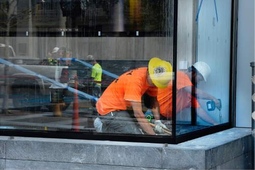Scott Sommerdorf   |  The Salt Lake Tribune   Crews put the finishing touches on the 111 Main St. high-rise next door to the new Eccles Theater on Main Street, Wednesday, August 31, 2016. There is a shortage of construction workers.