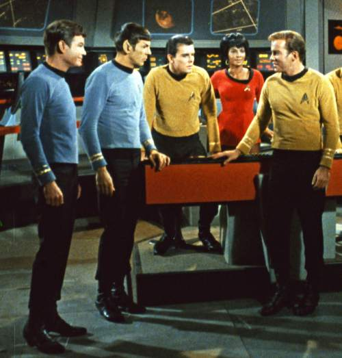 "FILE - This undated In this undated file photo released by Paramount Pictures, DeForest Kelley, left, Leonard Nimoy, second left, Nichelle Nichols, second right and William Shatner, right, appear in a scene from the TV series ""Star Trek."" (AP Photo/Paramount Pictures, File)"