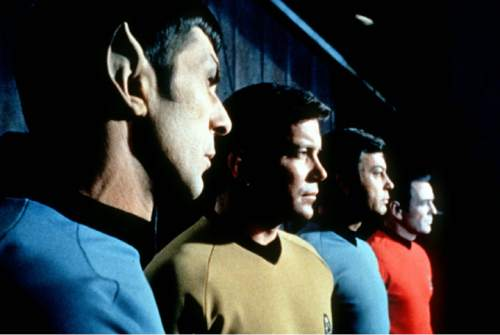 "FILE- This undated file photo shows actors in the TV series ""Star Trek,"" from left, Leonard Nimoy as Commander Spock, William Shatner as Captain Kirk, DeForest Kelley as Doctor McCoy and James Doohan as Commander Scott.(AP Photo/Paramount Television ,File)"