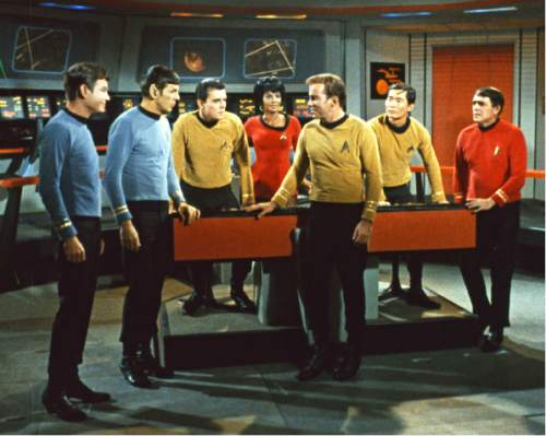 "In this undated photo released by Paramount Pictures, James Doohan, far right, who played Scotty in the original ""Star Trek"" television series and movies is seen. Doohan died on Wednesday, July 20, 2005. Cast members from left are DeForest Kelley, Leonard Nimoy, Walter Koenig, Nichelle Nichols, William Shatner, George Takei, and Doohan.  Doohan was 85. (AP Photo/Paramount)"