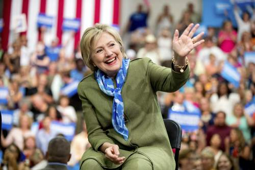 Democratic presidential candidate Hillary Clinton waves to members of the audience as she arrives at a rally at Adams City High School in Commerce City, Colo., Wednesday, Aug. 3, 2016. (AP Photo/Andrew Harnik)