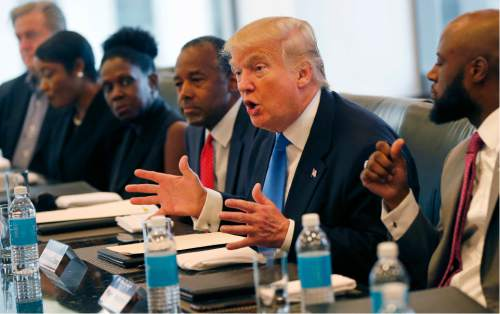 Republican presidential candidate Donald Trump holds a roundtable meeting with the Republican Leadership Initiative in his offices at Trump Tower in New York, Thursday, Aug. 25, 2016. Dr. Ben Carson is seated next to Trump at center. (AP Photo/Gerald Herbert)