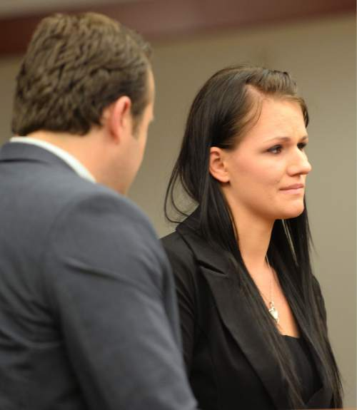 Steve Griffin / The Salt Lake Tribune  Carolyn Hughes stands with her attorney Steve Burton as she listens to Judge Katie Bernards-Goodman during her preliminary hearing at the Matheson Courthouse in Salt Lake City Thursday June 23, 2016.  Hughes is charged with a Class A misdemeanor count of negligent homicide for failing to restrain her 3-year-old daughter in a car.