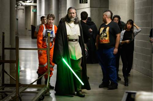 "Scott Sommerdorf   |  The Salt Lake Tribune   Costumed Star Wars characters make their way to the Vivint Arena floor where a CominCon event was underway, close tot he arrival area for Governor Mike Pence and others arriving to speak at ""Utah Solutions Summit"" at Vivint Smart home Arena, Thursday, September 1, 2016."