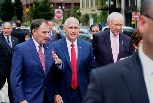 Scott Sommerdorf   |  The Salt Lake Tribune   Utah Gov. Gary Herbert, Indiana Gov. Mike Pence, and U.S. Sen. Orrin Hatch walk together as a tour of Temple Square begins, Thursday, September 1, 2016.