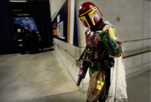 "Scott Sommerdorf   |  The Salt Lake Tribune   Costumed Star Wars characters make their way to the Vivint Arena floor where a CominCon event was underway, close to the arrival area for Governor Mike Pence and others arriving to speak at ""Utah Solutions Summit"" at Vivint Smart home Arena, Thursday, September 1, 2016."