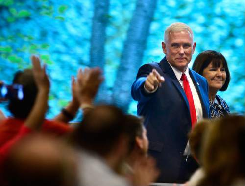 "Scott Sommerdorf   |  The Salt Lake Tribune   Indiana Governor Mike Pence acknowledges applause as he arrives to speak at ""Utah Solutions Summit"" at Vivint Arena, Thursday, September 1, 2016."
