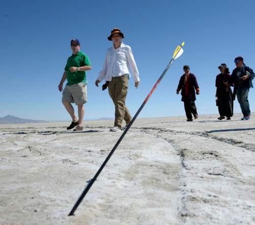 Al Hartmann  |  The Salt Lake Tribune Archers at the U.S. Flight Archery Association's annual meet walk several hundred meters from the shooting line to find their arrows on the Salt Flats on Friday. This is a big event with international competitors where archers shoot for distance with different kinds of bows, from high tech crossbows to traditional primative wooden bows. Most are handmade with different pull weights .