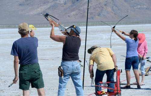 Al Hartmann  |  The Salt Lake Tribune Archers let loose their arrows during the first round shoot at the U.S. Flight Archery Association's annual meet on the Salt Flats Friday.  It runs through Sunday. This is a big event with international competitors where  archers shoot for distance with different kinds of bows, from high tech crossbows to traditional primative wooden bows.  Most are handmade with different pull weights .