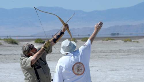 Al Hartmann  |  The Salt Lake Tribune David Hayes of Brigham City let loose an arrow  during the first round shoot at the U.S. Flight Archery Association at their annual meet on the Salt Flats Friday.  It runs through Sunday. This is a big event with international competitors where  archers shoot for distance with different kinds of bows, from high tech crossbows to traditional primative wooden bows.  Most are handmade with different pull weights .