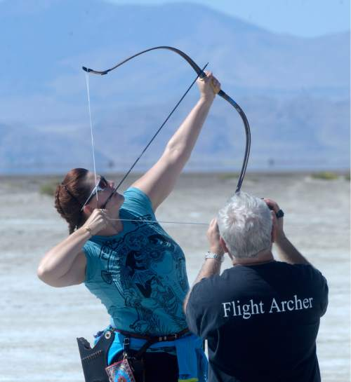 Al Hartmann  |  The Salt Lake Tribune Carla McAnulty-Lueck of Seattle lets an arrow loose during the first round shoot at the U.S. Flight Archery Association's annual meet on the Salt Flats on Friday. She holds five world records. It runs through Sunday. This is a big event with international competitors where archers shoot for distance with different kinds of bows, from high tech crossbows to traditional primative wooden bows.  Most are handmade with different pull weights.
