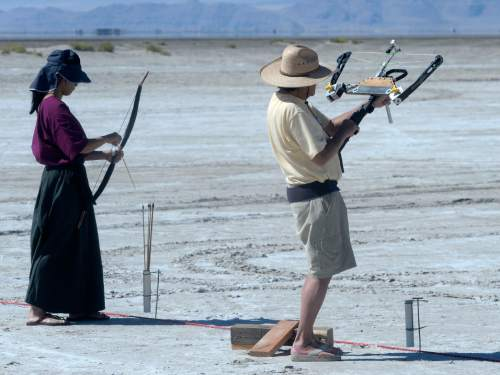 Al Hartmann  |  The Salt Lake Tribune Archers shoot their arrows during the first round  at the U.S. Flight Archery Association's annual meet on the Salt Flats Friday.  It runs through Sunday. This is a big event with international competitors where  archers shoot for distance with different kinds of bows, from high tech crossbows to traditional primative wooden bows.  Most are handmade with different pull weights .