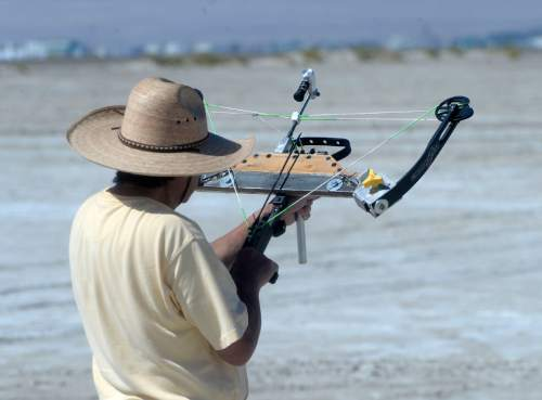 Al Hartmann  |  The Salt Lake Tribune Gerald Toriumi of California shoots his custom made crossbow at the U.S. Flight Archery Association's annual meet on the Salt Flats Friday.  It runs through Sunday.  This is a big event with international competitors in which archers shoot for distance with different classes of bows, from high tech crossbows to traditonal primative wooden bows.  Most are handmade with different pull weights .