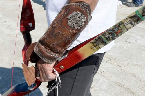 Al Hartmann  |  The Salt Lake Tribune Homemade bow with it artwork at the U.S. Flight Archery Association's annual meet on the Salt Flats Friday. It runs through Sunday. This is a big event with international competitors where  archers shoot for distance with different kinds of bows, from high tech crossbows to traditional primative wooden bows. Most are handmade with different pull weights.