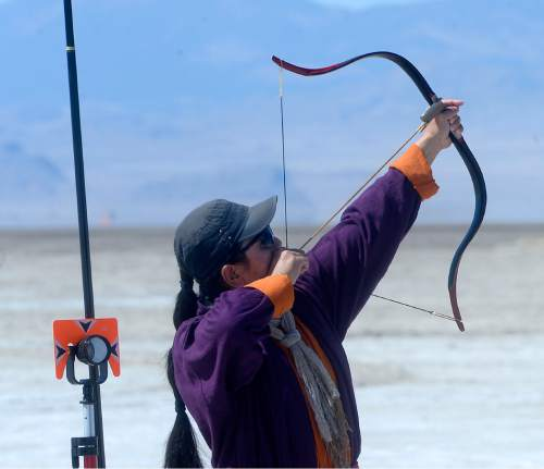 Al Hartmann  |  The Salt Lake Tribune Hsu Jack from Taiwan shoots an arrow with a traditional primitive bow during the first round at the U.S. Flight Archery Association's annual meet on the Salt Flats Friday. He is a world record holder in the category.  It runs through Sunday. This is a big event with international competitors where  archers shoot for distance with different kinds of bows, from high tech crossbows to traditional primative wooden bows.  Most are handmade with different pull weights .