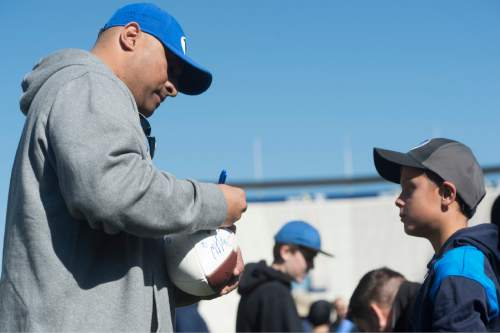Rick Egan  |  The Salt Lake Tribune  Michael Sumko gets an autograph from BYU Head Coach Kalani Sitake, after the final practice of spring camp, at LaVell Edwards Stadium, Friday, April 1, 2016.