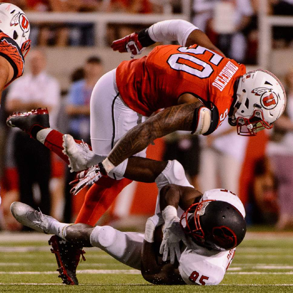 Trent Nelson  |  The Salt Lake Tribune Utah Utes defensive end Pita Taumoepenu (50) takes down Southern Utah Thunderbirds wide receiver Raysean Pringle (85) as the University of Utah Utes host the Southern Utah University Thunderbirds, NCAA football at Rice-Eccles Stadium in Salt Lake City, Thursday September 1, 2016.