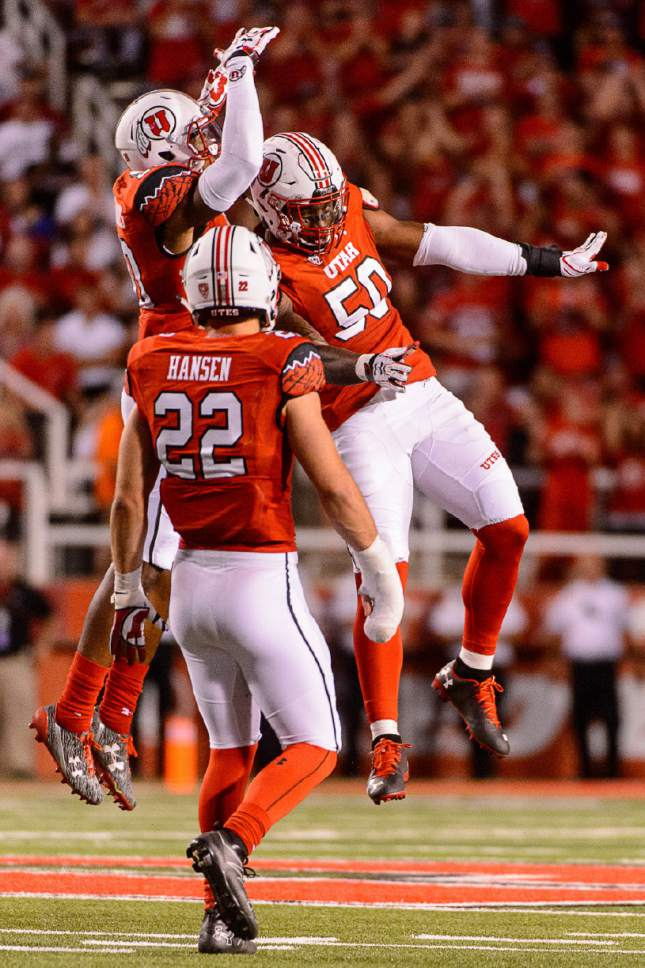 Trent Nelson  |  The Salt Lake Tribune Utah Utes defensive end Pita Taumoepenu (50) celebrates a tackle with teammate Marcus Williams (20) as the University of Utah Utes host the Southern Utah University Thunderbirds, NCAA football at Rice-Eccles Stadium in Salt Lake City, Thursday September 1, 2016.