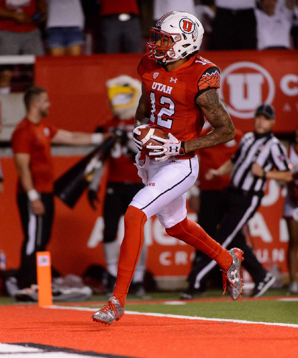 Trent Nelson  |  The Salt Lake Tribune Utah Utes wide receiver Tim Patrick (12) scores in the fourth quarter as the University of Utah Utes host the Southern Utah University Thunderbirds, NCAA football at Rice-Eccles Stadium in Salt Lake City, Thursday September 1, 2016.