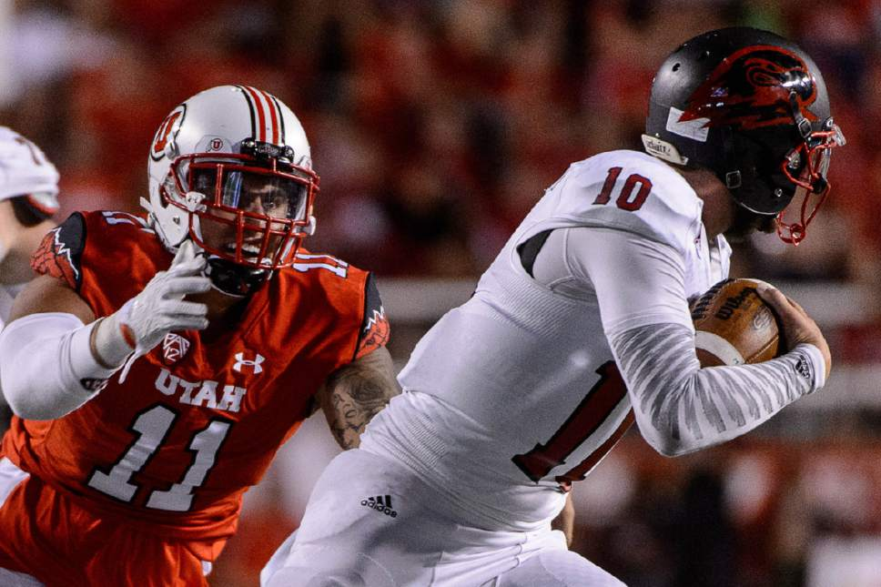 Trent Nelson  |  The Salt Lake Tribune Utah Utes defensive end Kylie Fitts (11) chases down Southern Utah Thunderbirds quarterback Tannon Pedersen (10) as the University of Utah Utes host the Southern Utah University Thunderbirds, NCAA football at Rice-Eccles Stadium in Salt Lake City, Thursday September 1, 2016.