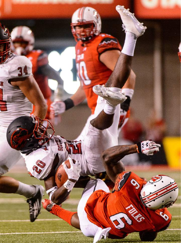 Trent Nelson  |  The Salt Lake Tribune Utah Utes wide receiver Kyle Fulks (6) trips up Southern Utah Thunderbirds cornerback Jhavari Ransom (20) after Ransom picked up a Utah fumble, as the University of Utah Utes host the Southern Utah University Thunderbirds, NCAA football at Rice-Eccles Stadium in Salt Lake City, Thursday September 1, 2016.