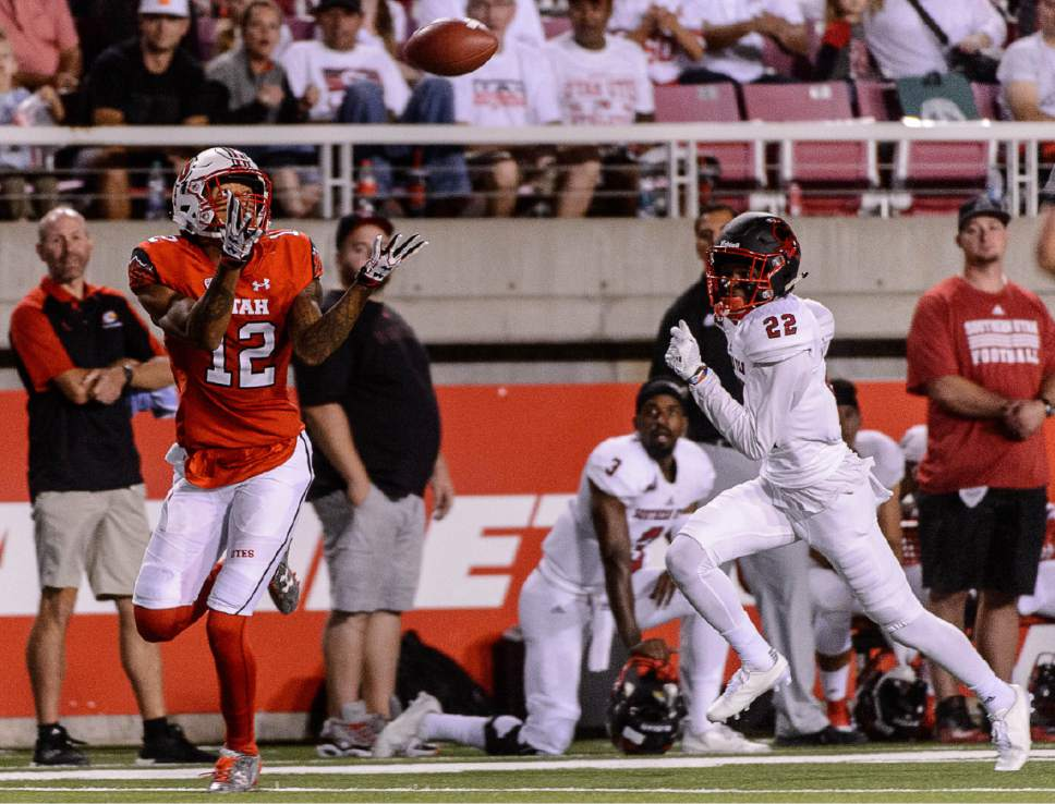 Trent Nelson  |  The Salt Lake Tribune Utah Utes wide receiver Tim Patrick (12) pulls in a pass and runs for a touchdown as the University of Utah Utes host the Southern Utah University Thunderbirds, NCAA football at Rice-Eccles Stadium in Salt Lake City, Thursday September 1, 2016.