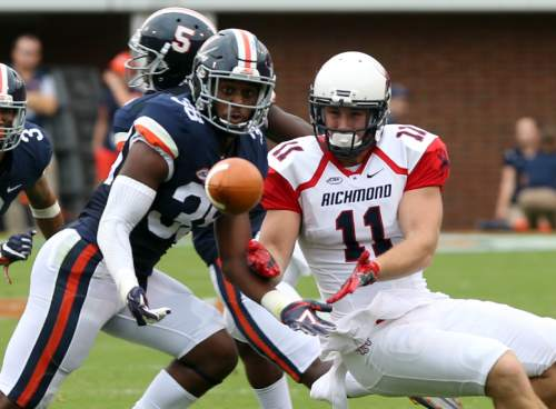Virginia safety Kelvin Rainey (38) nearly intercepts a pass intended for Richmond tight end Garrett Hudson (11) during the first half of an NCAA football game Saturday Sept. 3, 2016, in Charlottesville, Va. (AP Photo/Andrew Shurtleff)