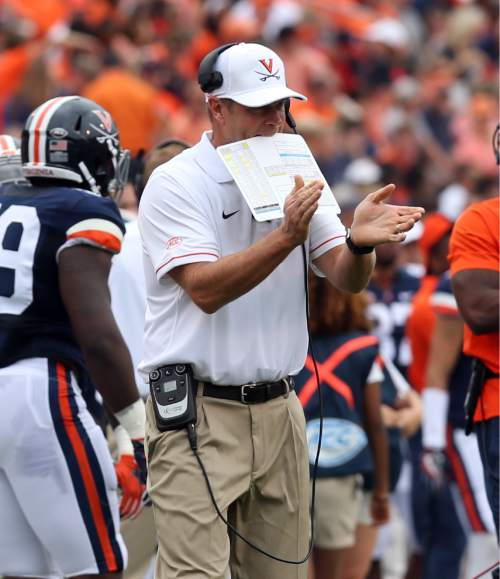 Virginia head coach Bronco Mendenhall watches from the sidelines during the first half of an NCAA football game against Richmond Saturday Sept. 3, 2016, in Charlottesville, Va. (AP Photo/Andrew Shurtleff)