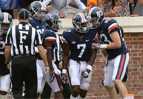 Virginia wide receiver Doni Dowling (7) celebrates a touchdown with teammates during the first half of an NCAA football game against Richmond Saturday Sept. 3, 2016, in Charlottesville, Va. (AP Photo/Andrew Shurtleff)