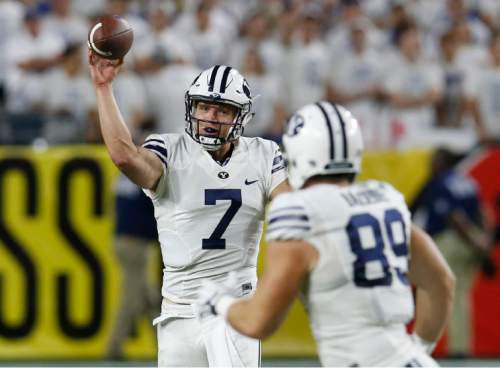 BYU quarterback Taysom Hill (7) throws to tight end Tanner Balderree for a first down during the first half of an NCAA college football game against Arizona, Saturday, Sept. 3, 2016, in Phoenix. (AP Photo/Rick Scuteri)