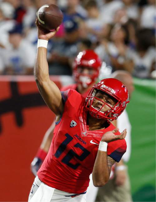 Arizona quarterback Anu Solomon warms up before an NCAA college football game against BYU, Saturday, Sept. 3, 2016, in Phoenix. (AP Photo/Rick Scuteri)