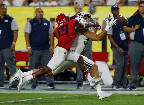 Arizona cornerback DaVonte' Neal (19) breaks up the pass intended for BYU wide receiver Nick Kurtz during the first half of an NCAA college football game, Saturday, Sept. 3, 2016, in Phoenix. (AP Photo/Rick Scuteri)