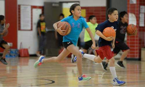 Francisco Kjolseth | The Salt Lake Tribune American Indian students participate in a self-esteem-boosting basketball program run by the Urban Indian Center, for youths grade 4 to 6, on a day when the program has a special guest: an Alaskan native and American basketball star Damen Bell-Holter.