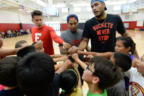Francisco Kjolseth | The Salt Lake Tribune Basketball instructors Dacian Spotted Elk, Clint Parks and Damen Bell-Holter, from left, gather the kids for a post workout cheer as part of a camp for American Indian students.