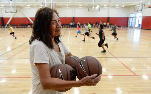 Francisco Kjolseth | The Salt Lake Tribune Jeanie Groves, with the Alpine school district Title 7 Indian Education Center, plays basketball with the kids participating in basketball camp created to help American Indian youth.